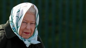 TOPSHOT - Britain s Queen Elizabeth II reacts during her visit to Wolferton Pumping Station in Norfolk  east of England on February 5  2020  where she officially opened the new station  - Wolferton Pumping Station allows the surrounding 7 000 acres of marshland  which sits below sea level  to be drained  dried out and farmed  The Queen s father  King George VI  opened the original station on February 2  1948  (Photo by Adrian DENNIS   POOL   AFP)