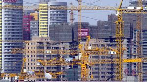epa00180662 Construction cranes fill the skyline of downtown Beijing Wednesday 28th April  Despite attempts to rein in overdevelopment in the property sector which seen by the leadership to threaten the economy with overheating  construction projects on an ever increasing scale can be seen throughout China  The economy is now growing at an annual rate of 9 7 percent  higher than the 9 2 percent when the measures to prevent overheating were introduced last year  EFE epa ADRIAN BRADSHAW