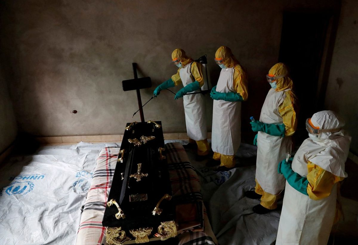 A healthcare worker sprays a room during a funeral ofa person who is suspected of dying of Ebola in BeniNorth Kivu Province of Democratic Republic of CongoREUTERS Goran Tomasevic File Photo