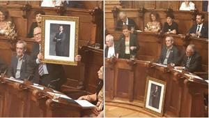 Bou esgrime el retrato del Rey, que luego ha dejado delante de su asiento, durante el pleno municipal de este lunes.