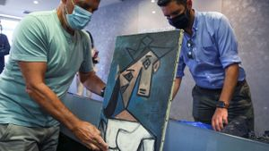 The paintings Woman's Head by Pablo Picasso, and Mill by Piet Mondrian are displayed at the Ministry of Citizen Protection in Athens
