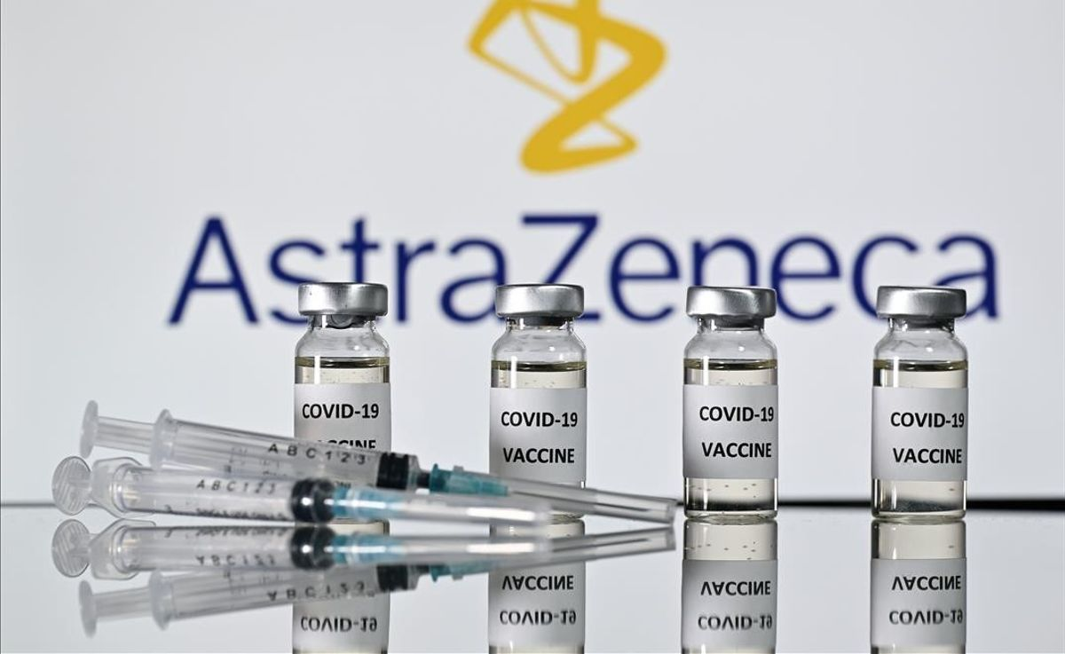 (FILES) In this file photo taken on November 17  2020 An illustration picture shows vials with Covid-19 Vaccine stickers attached and syringes with the logo of British pharmaceutical company AstraZeneca  - Pharmaceutical giant AstraZeneca s Russian branch said on December 11  2020 it would use part of Russia s homemade Sputnik V vaccine in further clinical trials  (Photo by JUSTIN TALLIS   AFP)