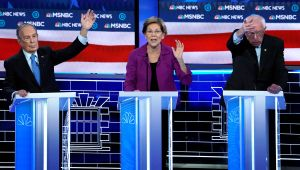 Senator Elizabeth Warren speaks as former New York City Mayor Mike Bloomberg and Senator Bernie Sanders try to get the moderators' attention at the ninth Democratic 2020 U.S. Presidential candidates debate at the Paris Theater in Las Vegas Nevada, U.S., February 19, 2020.     TPX IMAGES OF THE DAY