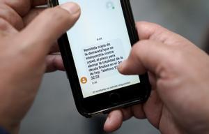 Mensaje de advertencia de la financiera Cetelem a un deudor por SMS.