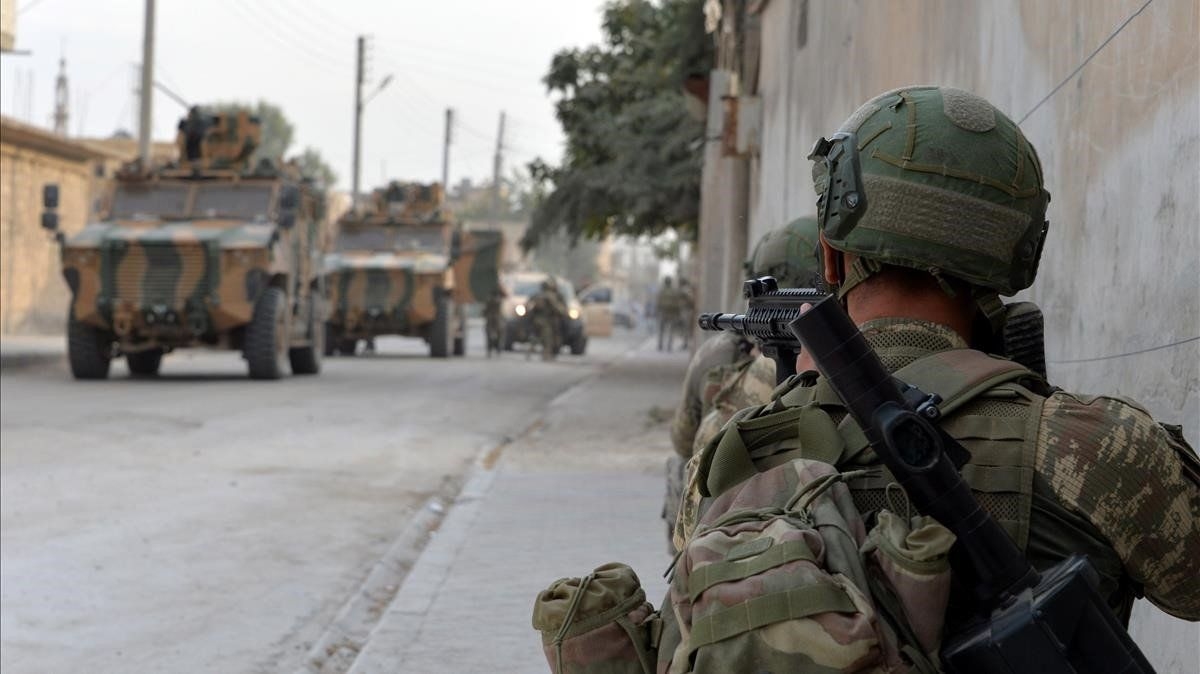 Soldados turcos en la ciudad fronteriza deTal Abyad, en el norte de Siria.