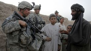 U.S. soldiers with the C Troop 1-71 CAV chat with residents as they patrol in the village of Gorgan June 25, 2010. REUTERS/Denis Sinyakov (AFGHANISTAN - Tags: CONFLICT MILITARY)