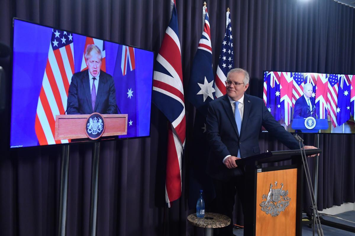 El primer ministro británico, Boris Johnson, su homólogo australiano, Scott Morrison, y el presidente de Estados Unidos, Joe Biden, emn una rueda de prensa conjunta tras anunciar la creación de la alianza AUKUS.