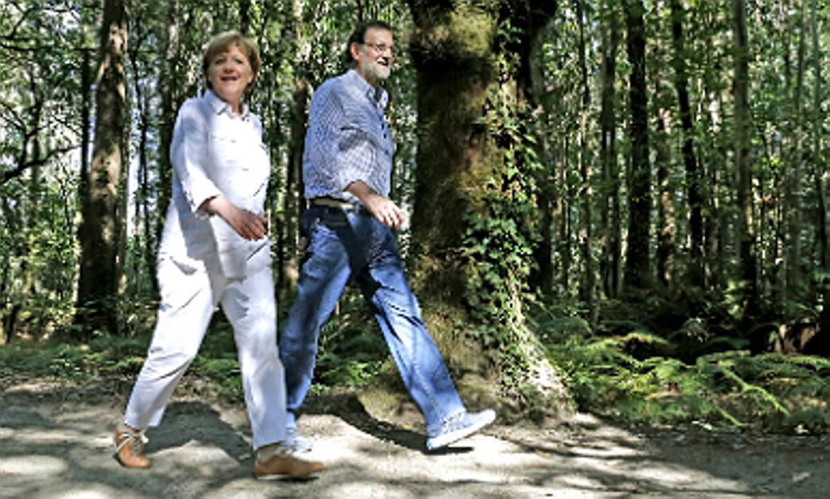 Merkel y Rajoy, en el Camino de Santiago.