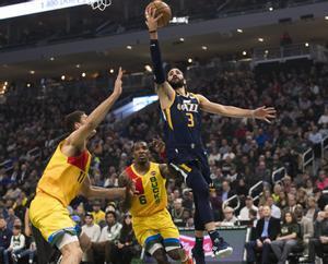 Jan 7, 2019; Milwaukee, WI, USA; Utah Jazz guard Ricky Rubio (3) shoots during the first quarter against the Milwaukee Bucks at Fiserv Forum. Mandatory Credit: Jeff Hanisch-USA TODAY Sports