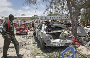 A Somali police officer says a number of people are wounded after a suicide bomber detonated an explosives-laden vehicle at a checkpoint outside the headquarters after being stopped by security forces.