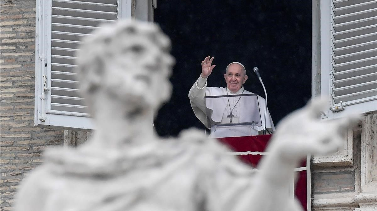Pope Francis waves from the window of the apostolic palace overlooking St  Peter s Square during the weekly Angelus prayer on February 7  2021 in the Vatican  during the Covid-19 pandemic  (Photo by Filippo MONTEFORTE   AFP)