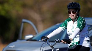 Brazil's suspended President Dilma Rousseff rides her bicycle near the Alvorada Palace a day before she will testify at the Brazilan Senate, in Brasilia, Brazil August 28, 2016. REUTERS/Ueslei Marcelino