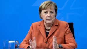 German Chancellor Angela Merkel attends a news conference following talks with state leaders to discuss anti-coronavirus measures at the Chancellery in Berlin  Germany December 13  2020     Bernd von Jutrczenka Pool via REUTERS