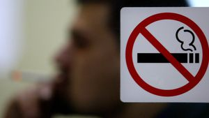 A Bulgarian man smokes cigarette in a cafe in central Sofia, January 16, 2005. Smoking is now forbidden in hospitals, schools, museums, day care centres and theatres. The Bulgarian government is giving the normally smoke-choked bars and bistros until June to introduce no-smoking tables and install costly ventilation-requirements that have angered restaurateurs. Picture taken January 16.  TO ACCOMPANY FEATURE BC-BULGARIA-SMOKING       REUTERS/Stoyan Nenov