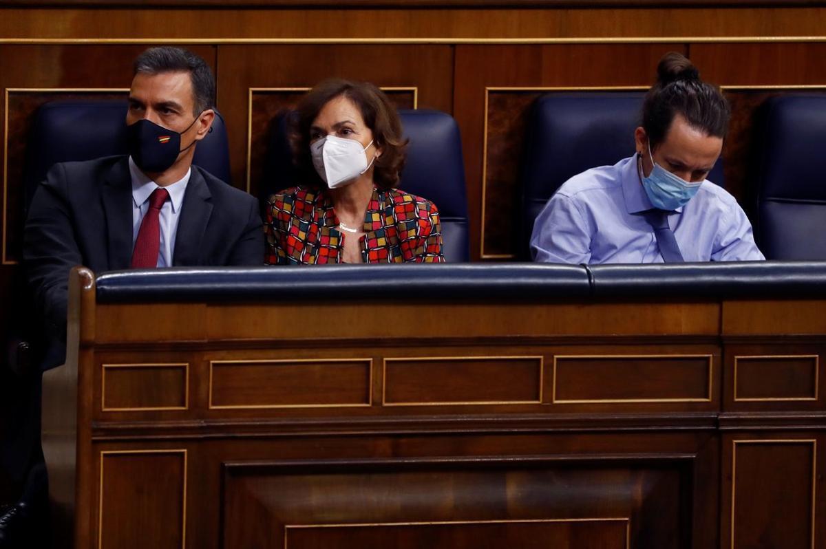 Pedro Sánchez y los vicepresidentes Carmen Calvo y Pablo Iglesias, al inicio del pleno del Congreso del pasado 11 de noviembre, en la primera jornada del debate de totalidad de los Presupuestos de 2021.