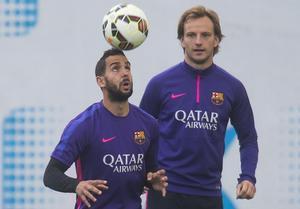 Montoya y Rakitic, en un entrenamiento del Barça de la pasada campaña.