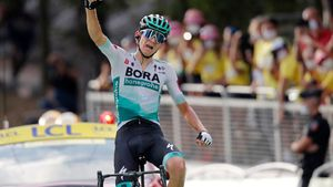 Cycling - Tour de France - Stage 16 - La Tour-du-Pin to Villard-de-Lans - France - September 15, 2020. BORA-Hansgrohe rider Lennard Kaemna of Germany wins the stage. Pool via REUTERS/Christophe Ena