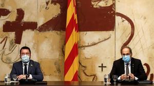 Quim Torra y Pere Aragonès en una imagen de archivo de un Consell Executiu. La silla del 'expresident' quedará vacía todo lo que resta de legislatura.