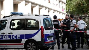 Police secure the area near the scene where French soliders were hit and injured by a vehicle in the western Paris suburb of Levallois-Perret  France  August 9  2017      REUTERS Benoit Tessier