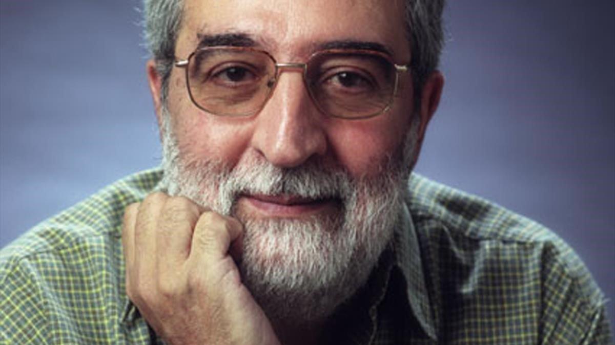 El escritor Domingo Santos.