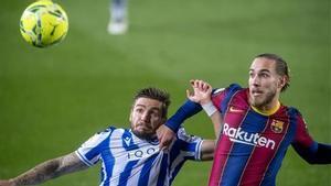 Mingueza pugna con Portu en el Barça-Real Sociedad.