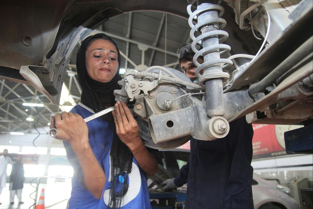 Pakistani motor mechanic Uzma Nawaz24fixes a car at an auto workshop in Multan- Since picking up a wrench as one of the first female car mechanics in conservative PakistanUzma Nawaz has faced two common reactionsshock and surpriseAnd then a bit of respectPhoto by S SMirzaAFP