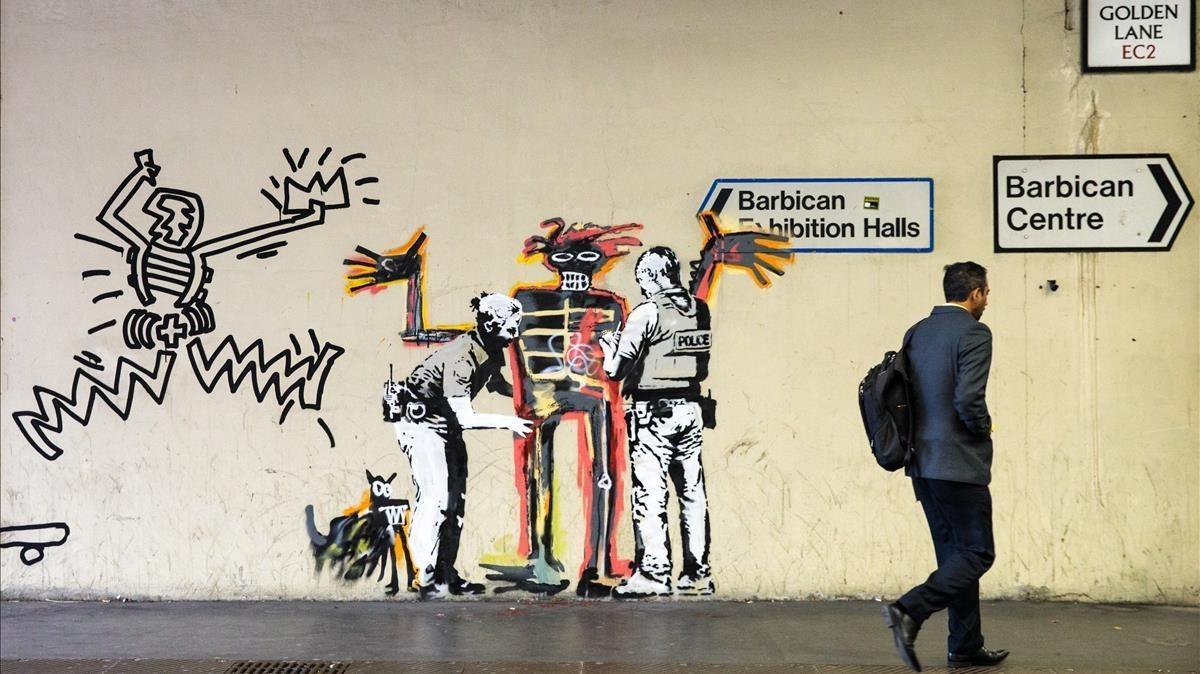 Obra de Banksy para promover la exposicin de Jean-Michel Basquiat en el Barbican Center de Londres.