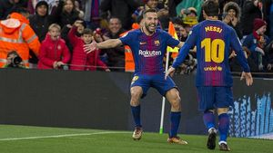 Messi celebra con Alba un gol del Barça ante el Celta.