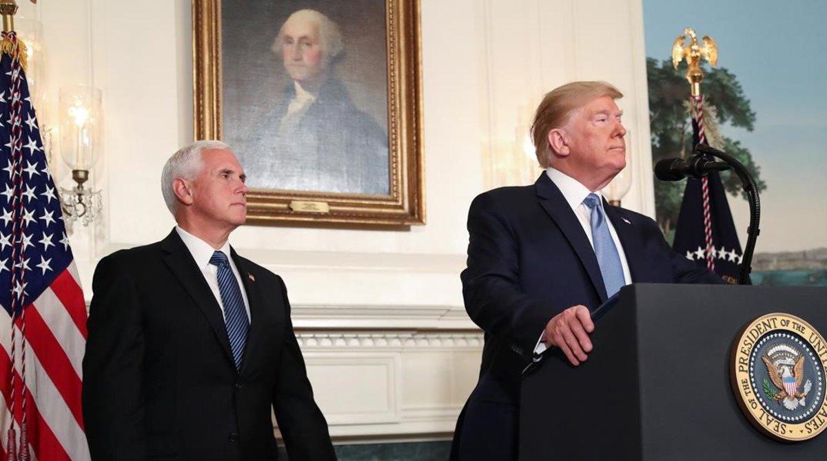 Trump y su vicepresidente, Mike Pence, durante la alocuciónde este lunes.