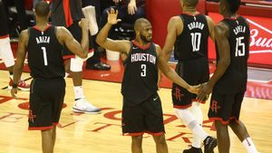 May 16, 2018; Houston, TX, USA; Houston Rockets guard Chris Paul (3) reacts with forward Trevor Ariza (1) guard Eric Gordon (10) and center Clint Capela (15) against the Golden State Warriors during the second half in game two of the Western conference finals of the 2018 NBA Playoffs at Toyota Center. Mandatory Credit: Troy Taormina-USA TODAY Sports