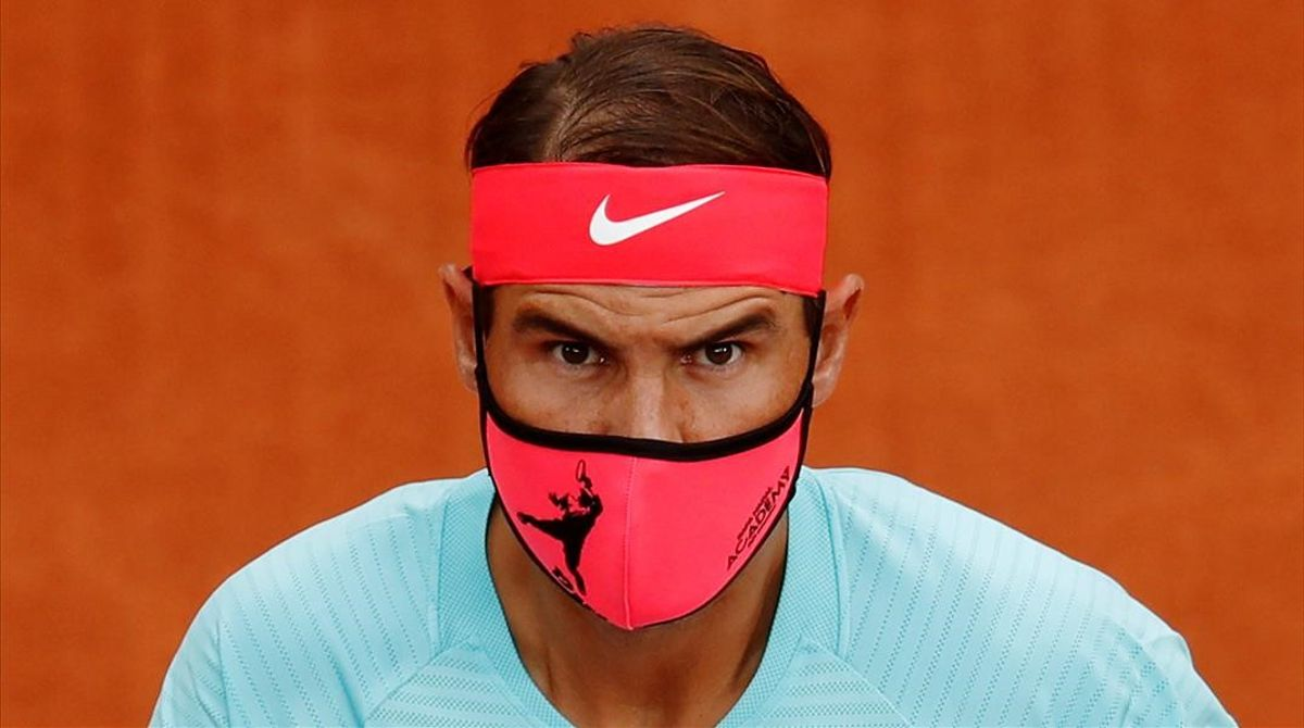 FILE PHOTO  Tennis - French Open - Roland Garros  Paris  France - September 28  2020 Spain s Rafael Nadal wears a protective face mask before his first round match against Belarus  Egor Gerasimov REUTERS Gonzalo Fuentes File Photo