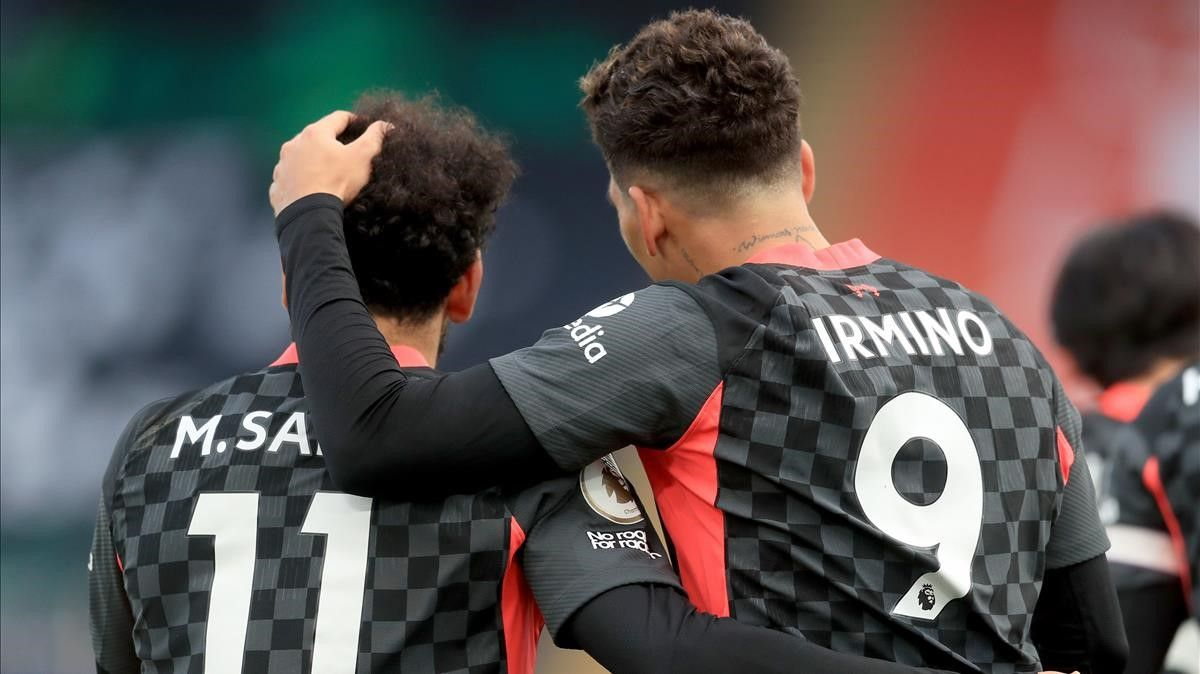 Firmino and Salah celebrate one of seven goals against Crystal Palace.