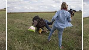 Petra Laszlo fa la traveta a un pare que porta a coll el seu fill i una bossa amb les seves pertinences, a Roszke (Hongria).