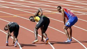 Bolt, a punto de recibir el último testigo del 4x100 jamaicano.