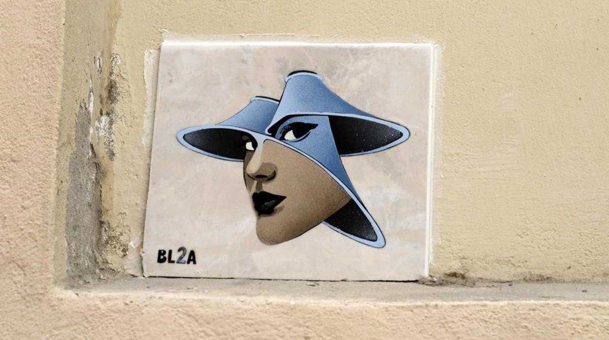 Azulejo firmado por BL2A en la calle dels Tiradors. Se pueden encontrar varios por Barcelona.
