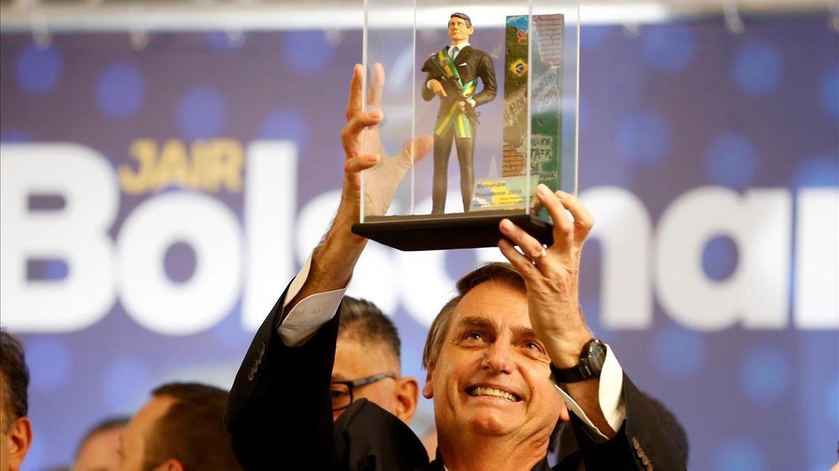 El candidato ultraderechista brasileño, Jair Bolsonaro, en un acto político enCuritiba el pasado mes de marzo.