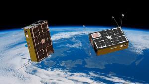 Dos nanosatélites en el espacio.