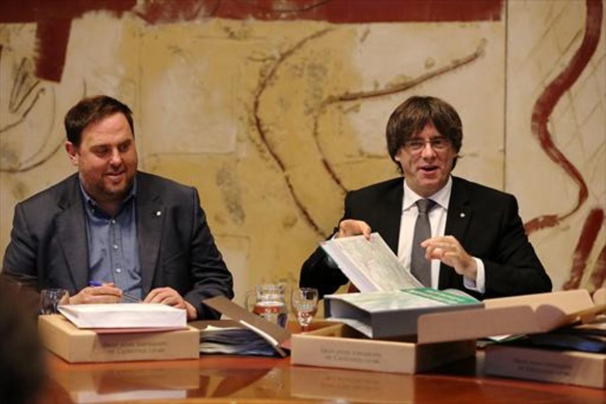 El vicepresidente Oriol Junqueras y el jefe del Govern, Carles Puigdemont.