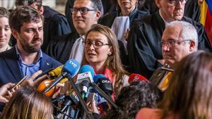 Los exconsellers Toni Comín, Lluis Puig y Meritxell Serret (de izquierda a derecha) hablan ante los medios de comunicación el pasado 16 de mayo.