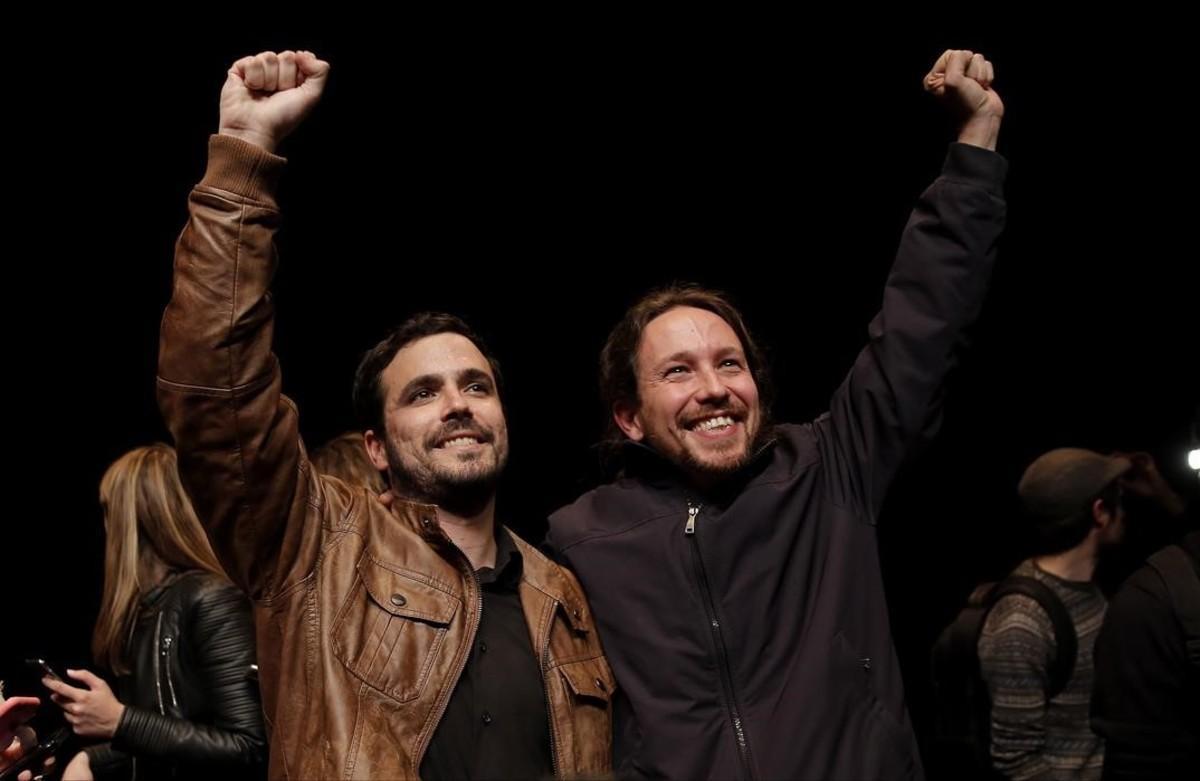 Iglesias y Garzón presentan el acuerdo en la Sala Mirador, en el barrio de Lavapiés (Madrid).