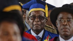Zimbabwe s President Robert Mugabe  center  arrives to preside over a student graduation ceremony at Zimbabwe Open University on the outskirts of Harare  Zimbabwe Friday  Nov  17  2017  Mugabe is making his first public appearance since the military put him under house arrest earlier this week   AP Photo Ben Curtis