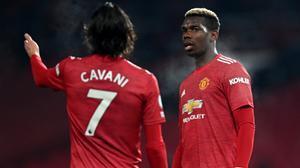 Cavani, junto a Pogba en un partido del United.