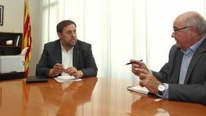 El'vicepresident'de la Generalitat, Oriol Junqueras,y el presidente del grupo de Catalunya Síque es Pot,Lluís Rabell.