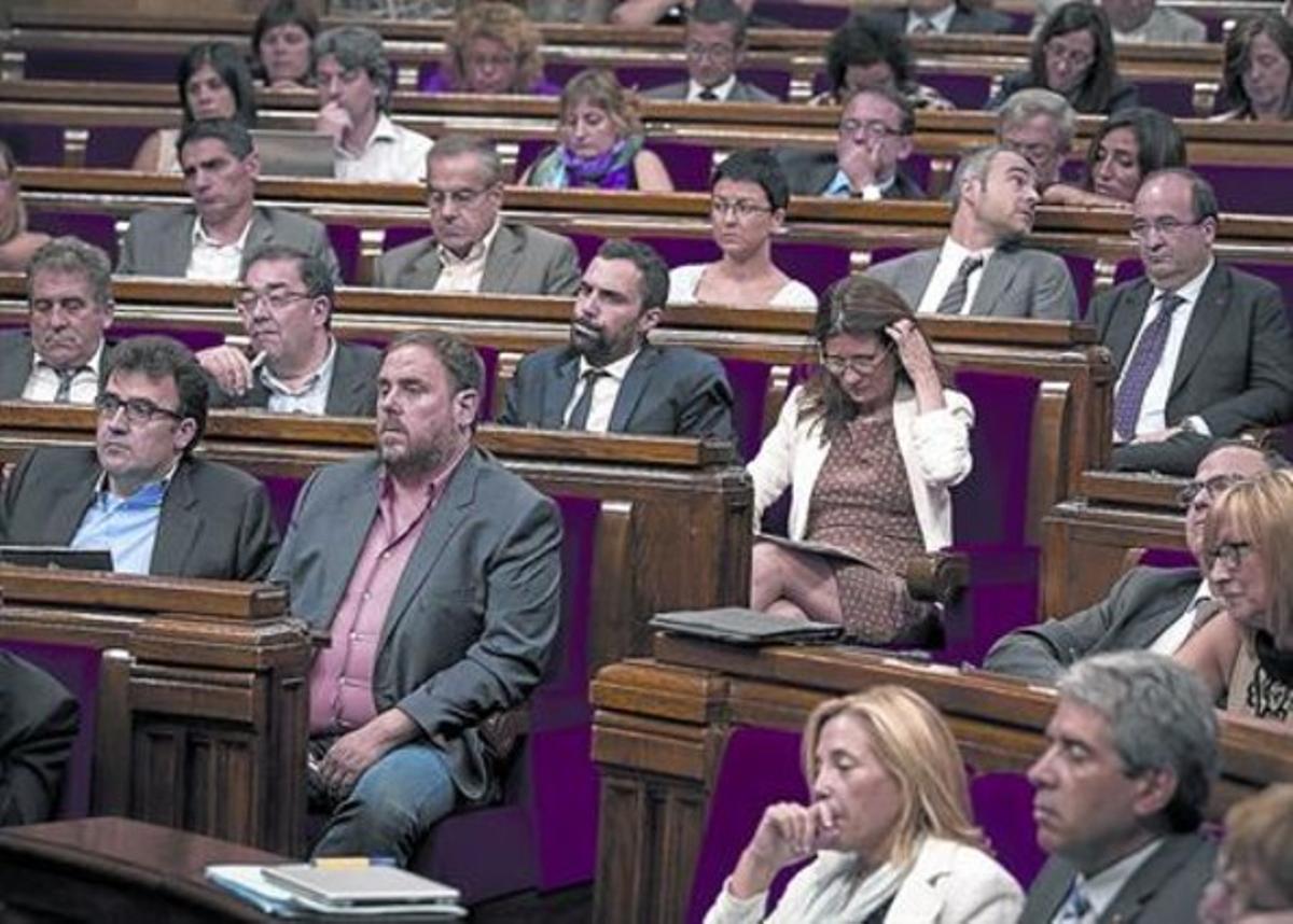 Los diputados siguen el discursode Artur Mas en el debate de política general, ayer.