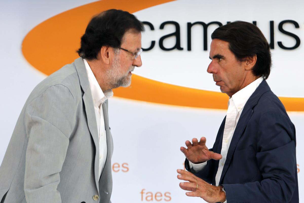 Aznar y Rajoy en un evento en el 2015.