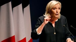 FILE PHOTO: France's far-right leader Marine Le Pen delivers a speech for the next year's municipal elections in an end-summer annual address to partisans in Frejus