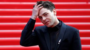 72nd??Cannes??Film Festival - After the screening of the film Matthias & Maxime (Matthias et Maxime) in competition - Red Carpet?? -??Cannes, France, May 22, 2019. Director Xavier Dolan reacts. REUTERS/Jean-Paul Pelissier