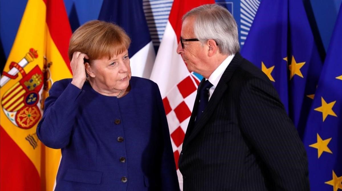 Merkel y Juncker al inicio de la cumbre informal sobre inmigración en Bruselas.