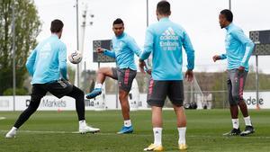 Courtois, Casemiro, Hazard y Militao, en el entrenamiento del Madrid de este viernes.