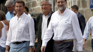 El presidente del PP y del Gobierno en funciones, Mariano Rajoy, junto a Alberto Núñez Feijoo en un acto en Pontevedra